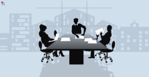 sombras de personas trabajando alrededor de una mesa